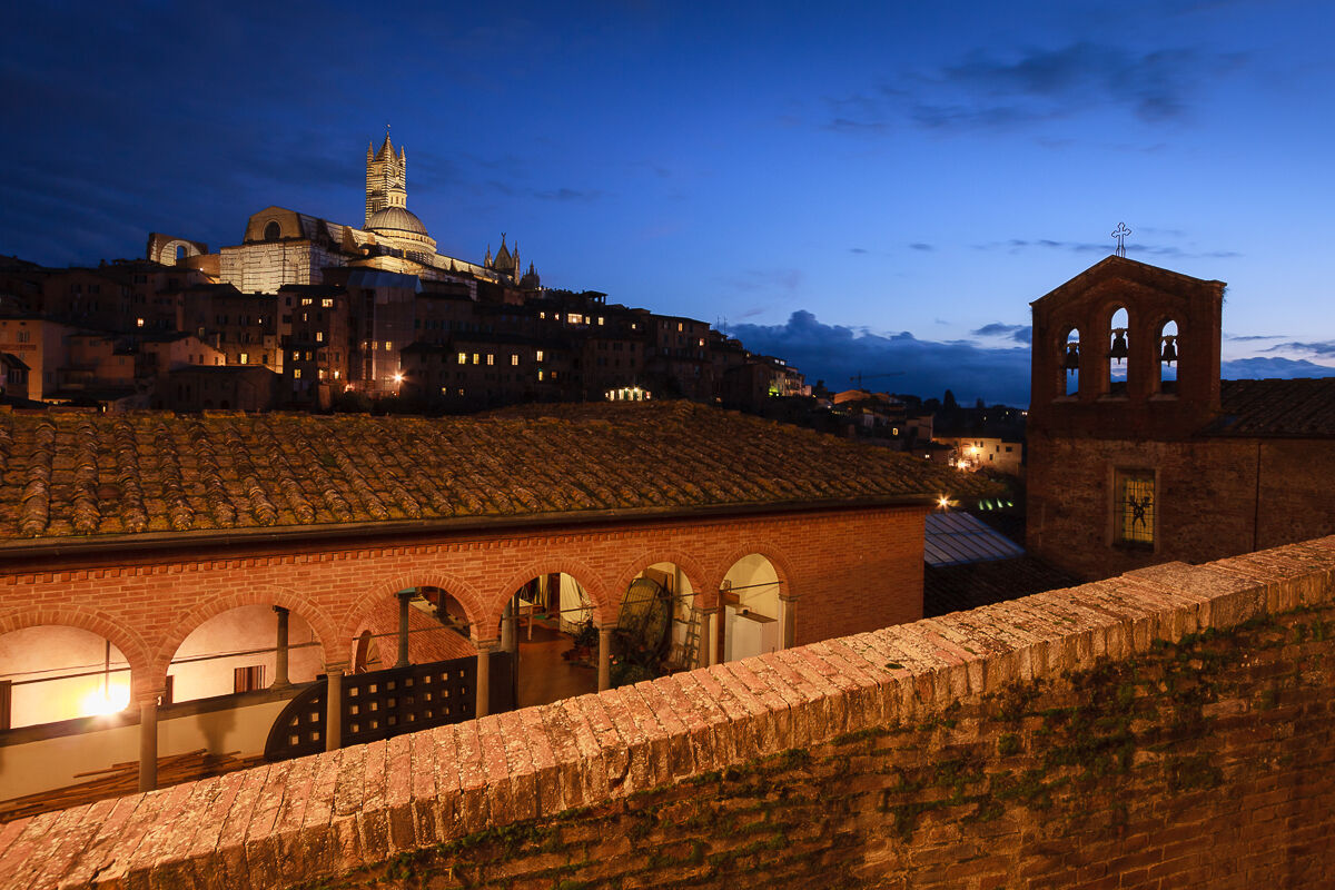 High on the hill the glory of Siena ......